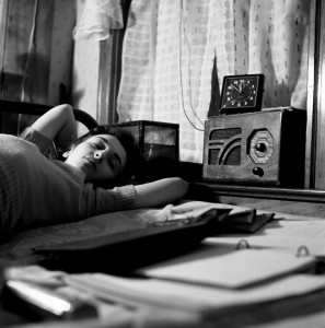 A radio is company for this girl in her boardinghouse room, Washington DC, 1943.